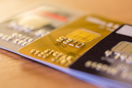 Credit Cards on Table Illustrate: What Happens to Credit Card Debt When You Die?
