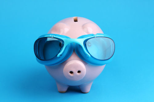 Pooled Trust: piggy bank wearing swim goggles