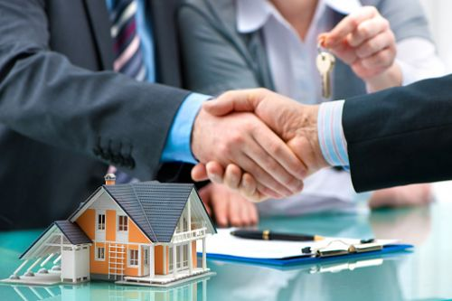 Hands Shaking at Consent Sale of Real Estate