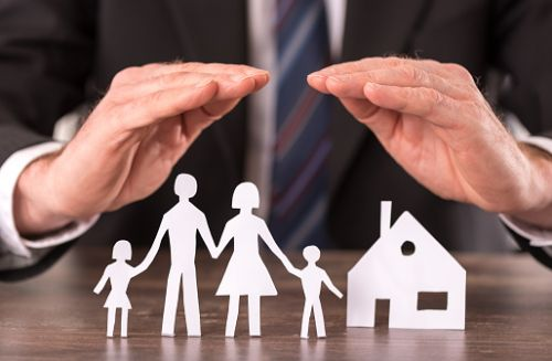 Hands Protecting Paper Doll Family - Concept of Life Insurance Trust
