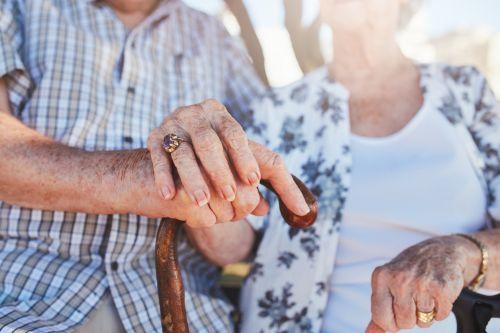 Joint Trust - Senior couple holding hands